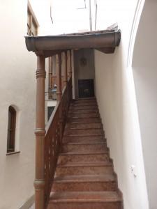 Wooden stairs at / Innenhof bei Schuhbeck in München
