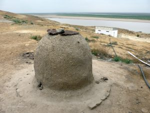 a typical clay oven for baking bread in Uzbekistan
