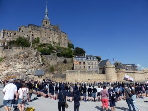 French scouts in front of Mont St. Michel
